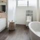 comfortable bathroom in modern design, wooden floor